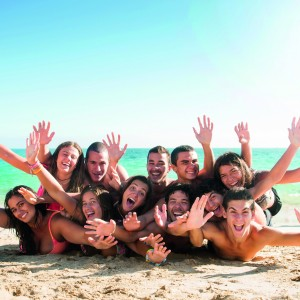 Group of happy teens at the beach