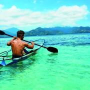 Summer Travel Kayaking. Man Canoeing Transparent Kayak In Ocean