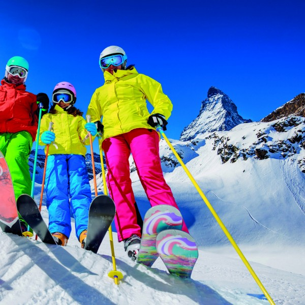 Skiing, winter, snow, sun and fun – family enjoying winter vacat