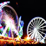 long exposure pictures of amusement park rides and wheels at night