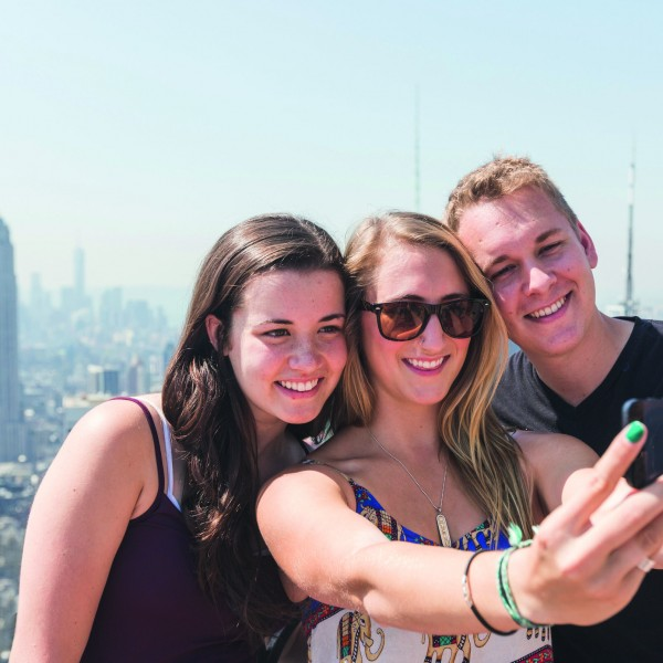 Friends Taking Selfie with New York on Background