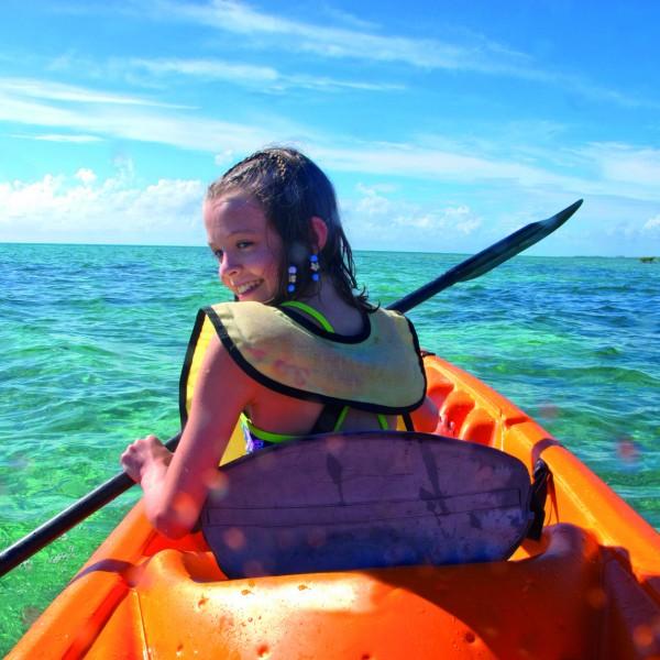 girl kayaking in the caribbean