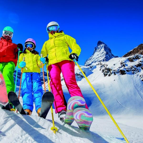 Skiing, winter, snow, sun and fun – family enjoying winter vacat